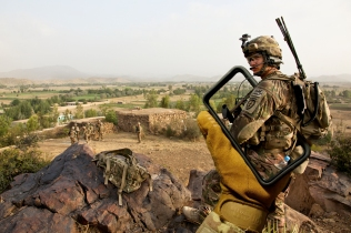 U.S. Army Spc. Jordan Duffy, a forward observer assigned to 1st Platoon, Apache Company, Team Apache, 1st Battalion (Airborne), 501st Infantry Regiment, Task Force 4-25, provides security from the top of a hill in Black Rock, Khowst province, Afghanistan, July 31, 2012. Team Apache conducted the patrol to investigate a previous attack to Combat Outpost Bak.